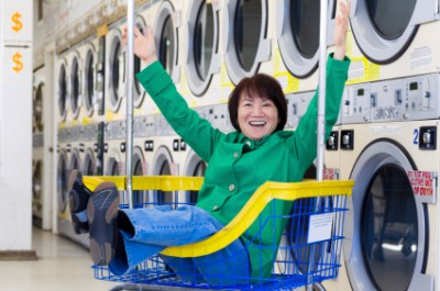 free and laughing at the laundromat